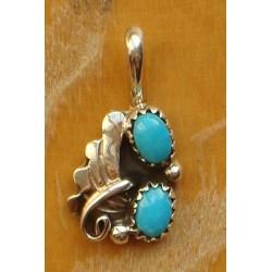 Pendentif navajo en argent et turquoises.