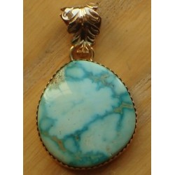 Pendentif navajo en plaqué or et turquoise.