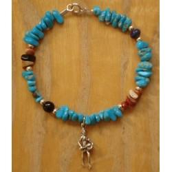Bracelet navajo en turquoises et pendentif indien en argent.