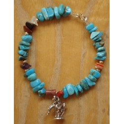 Bracelet navajo en turquoises et breloque indienne en argent.
